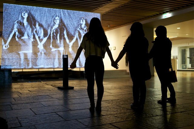 Visitors enjoying 'Snow Mirror'  by Daniel Rozin Photo  Liza Lemsatef Cunningham